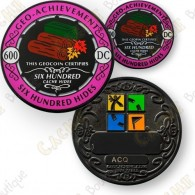 This set includes a geocoin trackable at  www.geocaching.com  and a pin.